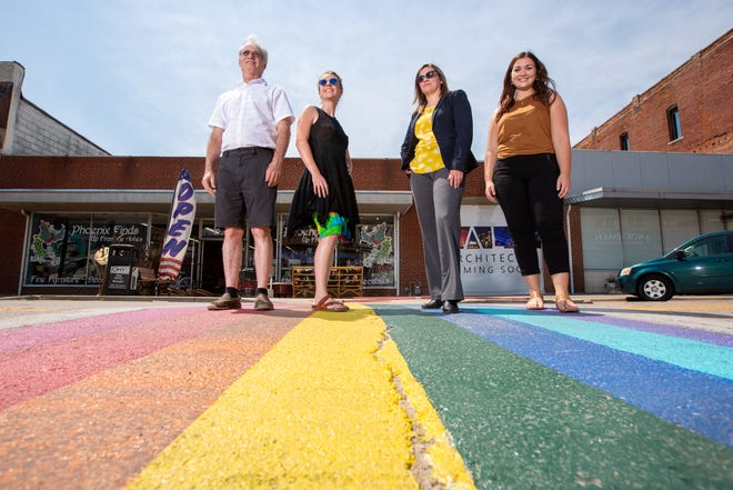 LGBTQ+ business owners, from left, Ken Liddle, Chelsea Smith, Nicole Revenaugh and Shelby Herring stand in NOTO's rainbow-colored crosswalk Thursday. The four local business owners said their identities encourage them to create open, inclusive business environments.