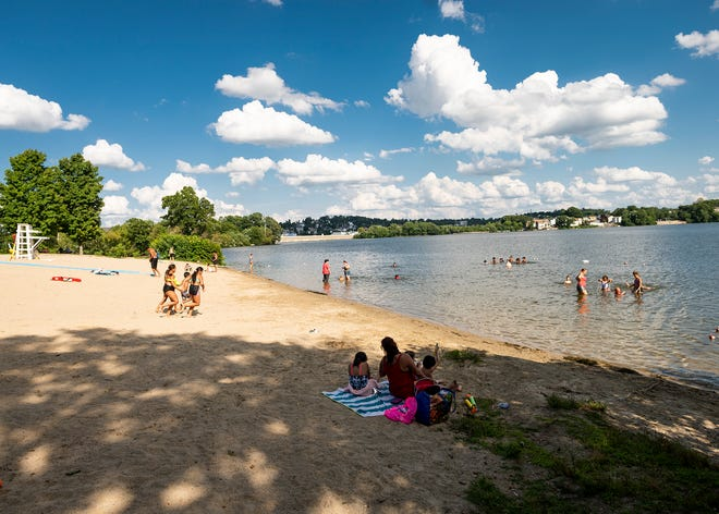 Swimmers enjoy a day at Shore Park in Worcester last August.