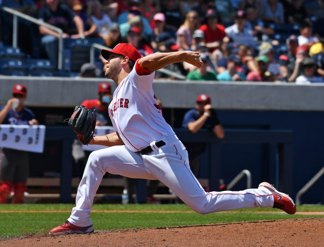 Matt Hall delivers for the WooSox Sunday during their game against Lehigh Valley.