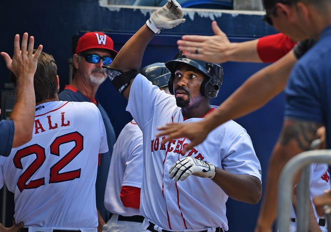 Josh Ockimey gets high fives after hitting a home run against Lehigh Valley in June.