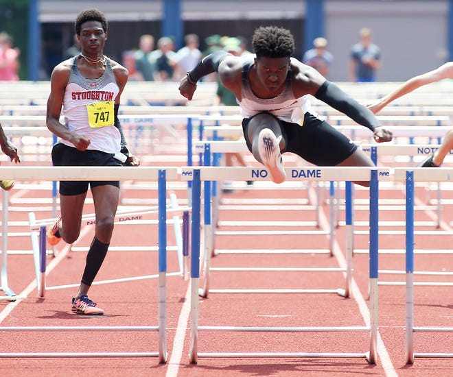 Stoughton's Jordan Emile clears the final hurdle and takes first place in the 110 hurdles with a time of 14.74 seconds during the Division 2 south track and field meet at Notre Dame Academy in Hingham on Saturday, June 19, 2021.