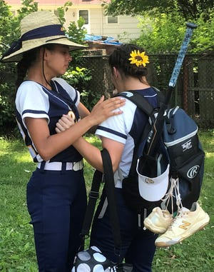 Clayton's Gianna Muhaw, left, and Meadow Lake console each other after Sunday's 3-2 loss to Donovan Catholic in the Tournament of Champions semifinal round at Ivy Hill Park. The Lady Clippers enjoyed their finest season in program history this spring.