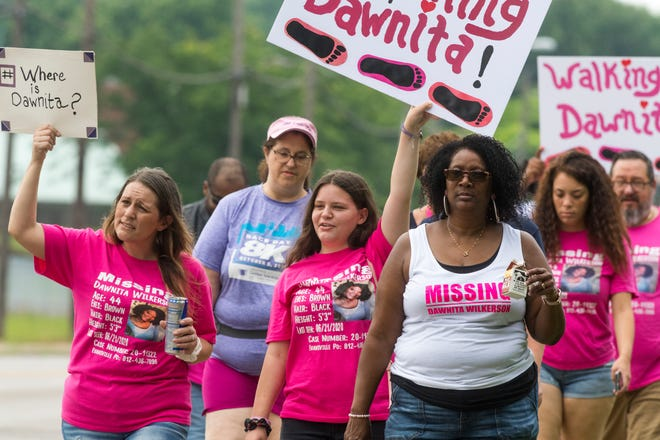 Family and friends walk along Boeke Road to raise awareness on the one-year mark since Dawnita Wilkerson went missing from Evansville, Ind., Saturday morning, June 19, 2021. Wilkerson was last seen on June 21, 2020, and a missing person investigation is ongoing.