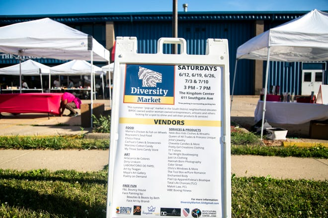 A board displays information during a Diversity Market event on Juneteenth, Saturday, June 19, 2021, outside the Kingdom Center Church in Iowa City, Iowa.
