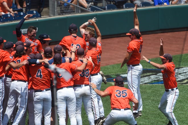 Jun 20, 2021; Omaha, Nebraska, USA; Virginia Cavaliers catcher Logan Michaels (12) celebrates with outfielder Chris Newell (9) after hitting a home run in the third inning against the Tennessee Volunteers at TD Ameritrade Park. Mandatory Credit: Steven Branscombe-USA TODAY Sports