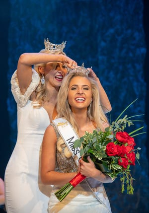 Lora Current of Rosewood is crowned Miss Ohio by outgoing Miss Ohio Caroline Grace Williams on Saturday night in the Renaissance Theatre in Mansfield.