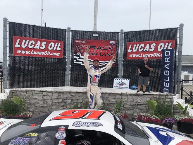 Seymour's Ty Majeski celebrates his victory in the rain-shortened Father's Day 100 at the Milwaukee Mile.