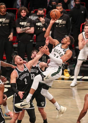 Bucks forward Giannis Antetokounmpo puts up a one-handed jump shot over Nets forward Blake Griffin in the second quarter of Game 7.