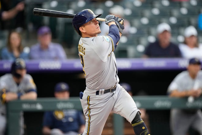 Luis Urias watches his double off Rockies starting pitcher Austin Gomber during the first inning  Saturday in Denver.