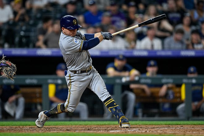 DENVER, CO - JUNE 17: Luis Urias #2 of the Milwaukee Brewers three-run double in the seventh inning against the Colorado Rockies at Coors Field on June 17, 2021 in Denver, Colorado. (Photo by Dustin Bradford/Getty Images)