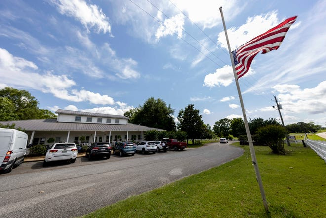 An American flag flies at half staff Sunday in Camp Hill, Ala., at the Alabama Sheriff's Girls Ranch, which suffered a loss of life when its van was involved in a multiple vehicle accident Saturday.