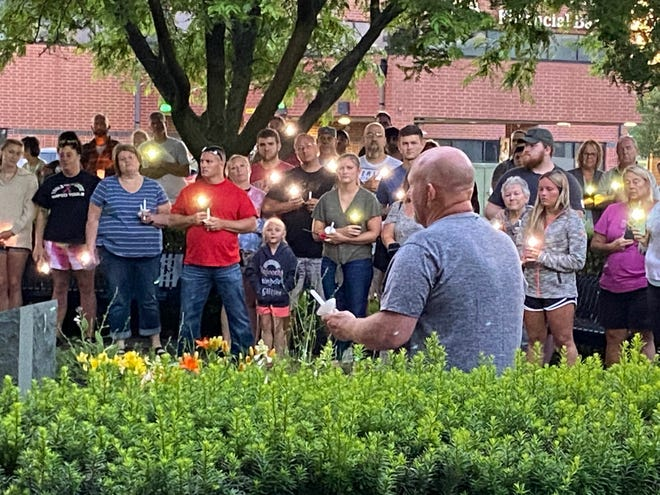 Ken Mace, brother of retired city police officer Kirk Mace, addresses a group estimated at 200 people last Monday at a candlelight vigil in downtown #Muncie. Kirk Mace and his wife, Deb, were critically injured June 13 in a motorcycle accident on U.S. 35. They died on Saturday in an Indianapolis hospital.