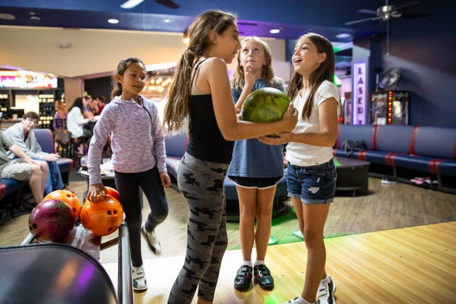 Grace Pacheco, 9, left, Arianna Batelli, 9, Kelly Wright, 10, and Olivia Silverio, 10, enjoy a bowling day together, Thursday, June 17, 2021,  at HeadPinz Naples.