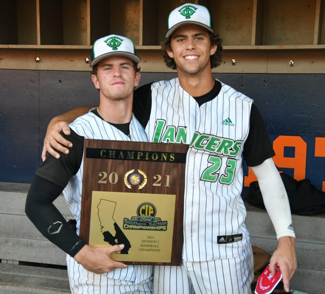 Roc Riggio, left, and Max Muncy pose with the championship plaque after Thousand Oaks won the Division 2 title. Muncy was named the CIF-SS player of the Year and Riggio made the CIF-SS first team.