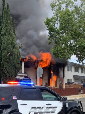 Intense flames erupt from a house on Talbert Avenue in Simi Valley on June 7, 2021. A resident sleeping inside died in the fire and prosecutors have filed murder charges in the case.