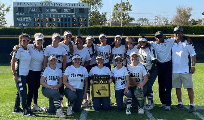The St. Bonaventure High softball team poses with the championship plaque after beating Perris-Orange Vista 4-2 in the CIF-Southern Section Division 6 championship Saturday afternoon in Irvine.