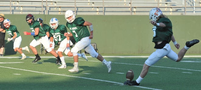 West kicker Chandler Dyer kicks off to the East during the 2021 Oil Bowl on Saturday, June 19, 2021, at Memorial Stadium.