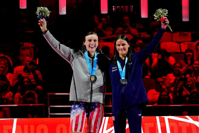 Katie Ledecky (left) and Katie Grimes celebrate during the medal ceremony for the women's 800 freestyle during the U.S. Olympic Team Trials in Omaha.