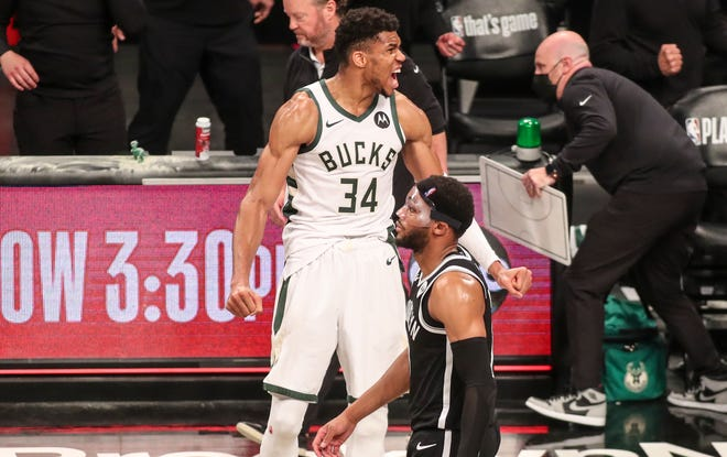 Second round: Giannis Antetokounmpo celebrates as Bruce Brown leaves the floor after the Bucks defeated the Nets in Game 7.