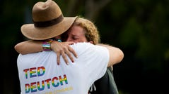 U.S. Rep. Debbie Wasserman Schultz of Florida is comforted after a truck drove into a crowd of people during a Pride parade in Wilton Manors near Fort Lauderdale on Saturday.