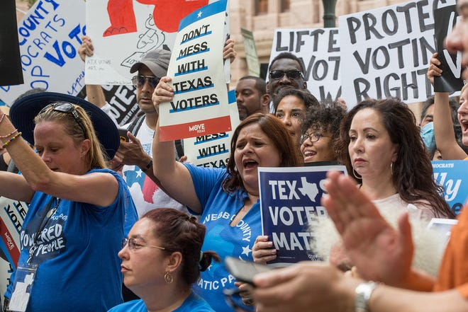 """Protesters cheer during the voting rights rally """"For the People: The Texas Drive For Democracy"""" at the Texas Capitol on June 20."""