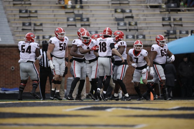 Georgia wide receiver George Pickens (1) joins offensive teammates including quarterback JT Daniels (18) in celebrating a touchdown during the Bulldogs game against Missouri in Columbia, Mo., on Saturday, Dec. 12, 2020. (Photo by Cassie Florido)