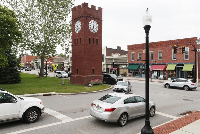 Traffic drives past the iconic clock tower at Aurora and Main streets in Hudson. James Ellsworth, who was born in Hudson in 1849, contracted New York architect Henry Hardenburg to design and build the 44-foot tower in 1912 in a traditional Romanesque style.