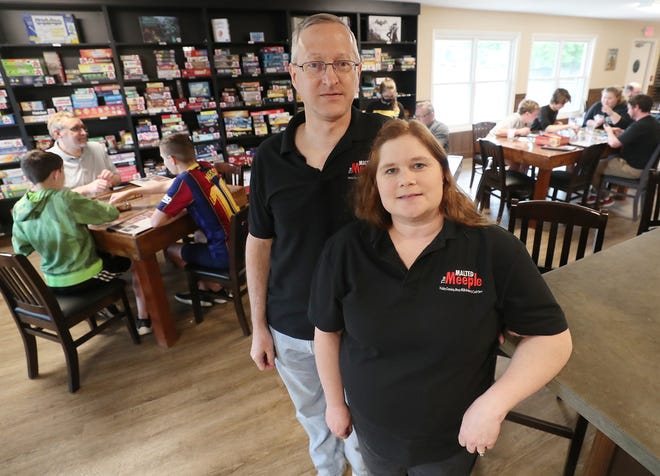 Jim and Pam Reed, co-owners of the Malted Meeple on Saturday June 19, 2021 in Hudson.  The board game cafe has close to 400 board games available to play as well as adult beverages and food and an escape room.