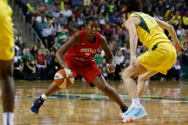 Washington Mystics guard Ariel Atkins dribbles the ball against Seattle Storm guard Sue Bird during their 2018 WNBA Finals game at KeyArena in Seattle. Atkins and Bird have both made this year's U.S. Olympic Team that will compete in Tokyo.
