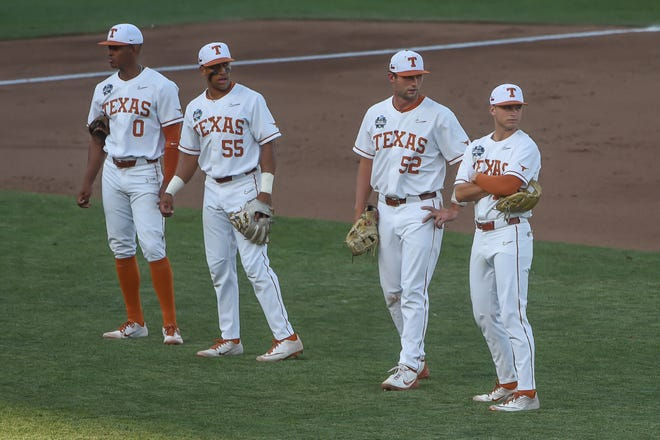 Texas players Trey Faltine, Cam Williams, Zach Zubia and Mitchell Daly wait during a break in the fourth inning of Sunday's 2-1 loss to Mississippi State to open the College World Series. Only three teams have come back after a first-game loss to win the CWS since 1998.