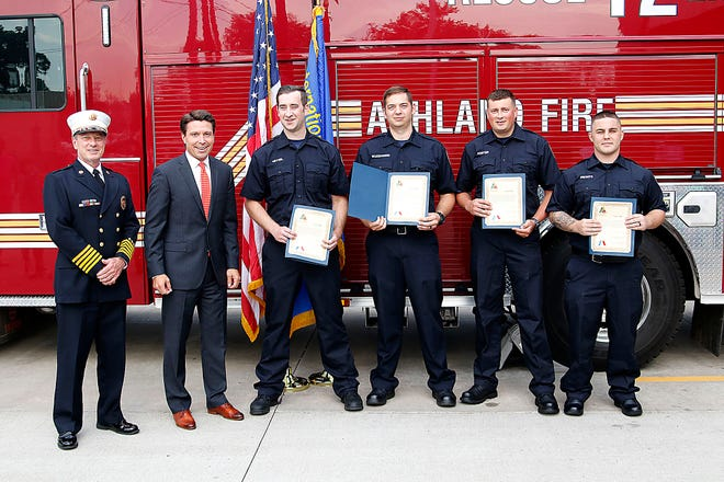 Ashland Fire Department Chief Rick Anderson (left to right) and Mayor Matt Miller stand with the city's newest firefighters, William Hetzel, Isaac Wojciechowski, David Foster and Trent Frontz.