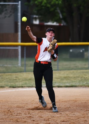 Ames third baseman Katie Riesselman fires a throw to first during the Little Cyclones game with No. 7 (4A) Boone at the Kiwanis Invitational Saturday in Roland.