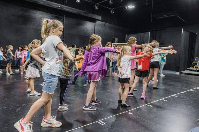 """Ava Faragher, front left, Lauren Eberhard, Katelyn Dohne, Anniston Ward and Reese Murray, along with 40 other youth, practice their audition piece for Children's Musical Theater's """"101 Dalmatians Kids"""". Performances will be at 3 and 6 p.m. July 2 and 3; tickets available online at cmtonstage.com."""