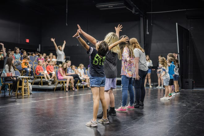 """Children's Musical Theater's summer camp participants practice their audition piece for Children's Musical Theater's """"101 Dalmatians Kids"""". Performances will be at 3 and 6 p.m. July 2 and 3; tickets available online at cmtonstage.com."""