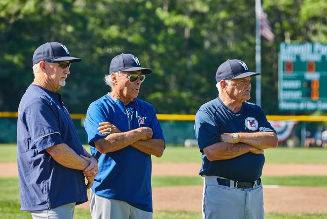 Wareham Gatemen manager Don Sneddon, assistant coach Jerry Weinstein and assistant coach Ron Polk, at right, stand with their team before the start of the Cape League opener at Lowell Park against the Cotuit Kettleers on Sunday.