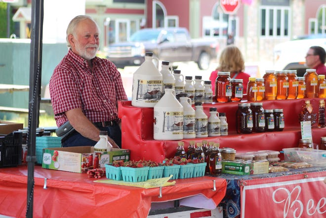 Lowell Beethem, who is a regular at the Cheboygan Farmers' Market, was one of the vendors at Festival Square during the Business Expo and Taste of the Straits. He was selling locally grown strawberries, honey and several other products.