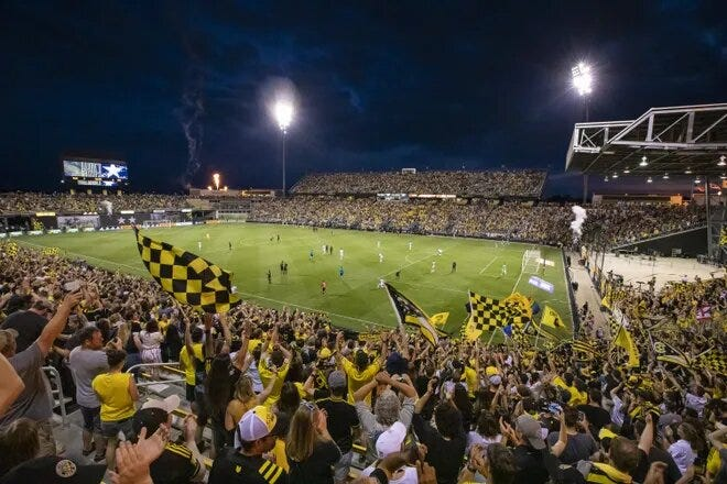 Fans cheer during the final game at Historic Crew Stadium