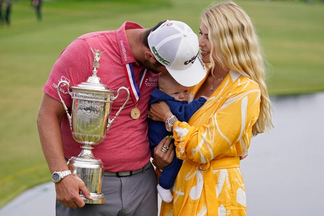 Jon Rahm shares the celebration of his victory with his wife, Kelley, and their son, Kepa, 11 months.