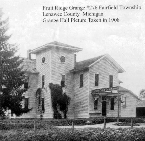 """The Fruit Ridge Grange Hall in Fairfield Township is pictured in this photo taken about 1908. The hall was considered by many to be """"one of the most complete farm halls in the United States."""" It had a museum, stage, library and assembly hall. The building eventually also housed a post office and store."""