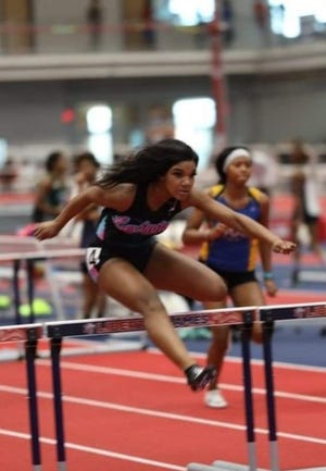 Lexington's Alyssa Thompson Rowe runs the hurdles during an indoor meet in 2020. Rowe's victory in the 100-meter hurdles in the 2-A Midwest championship meet was rated as an elite performance by ncmilesplit. [ncmilesplit photo]