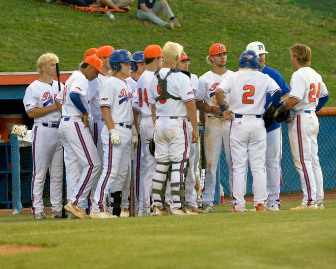 Randleman coach Jake Smith confers with his players during a Southwest Onslow pitching change on Thursday. [Mike Duprez/Courier-Tribune]
