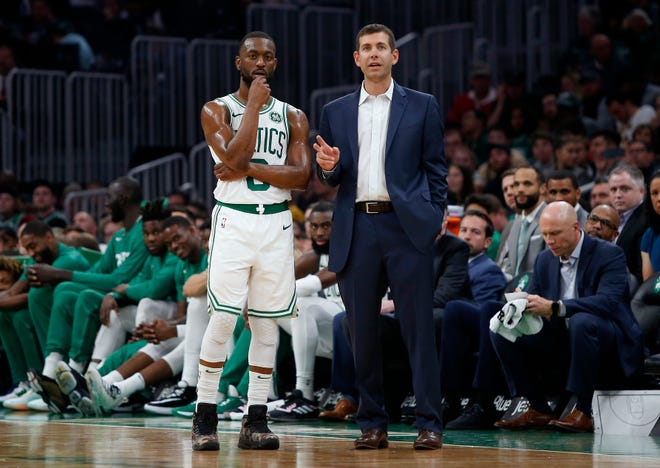 Oct 13, 2019; Boston, MA, USA; Boston Celtics head coach Brad Stevens talks with Boston Celtics guard Kemba Walker (8)nduring the first half of a preseason game against the Cleveland Cavaliers at TD Garden.