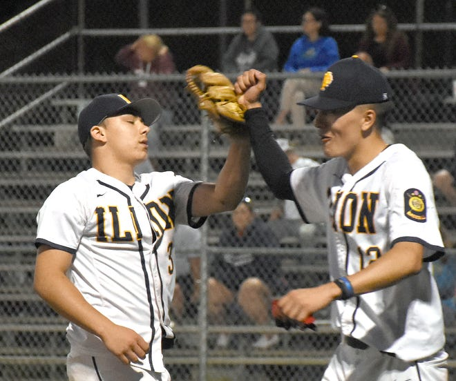 Nick Greene is greeted by Ilion Post teammate Noah Carpenter (right) on his way to the dugout after striking out the final two batters of Sunday's 7-6 win over Oriskany Post.
