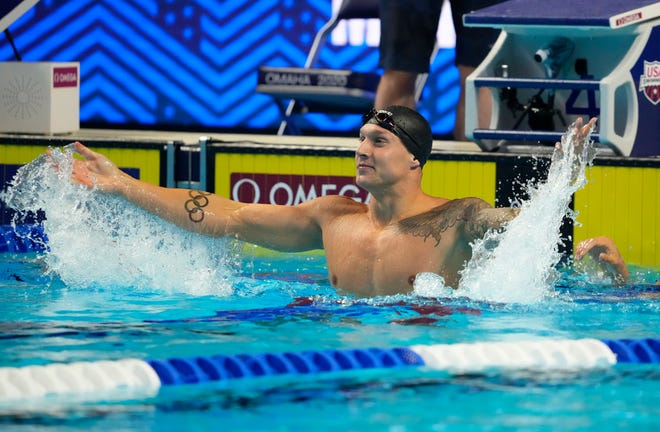 Caeleb Dressel celebrates after winning the men's 50m freestyle during the U.S. Olympic Team Trials Swimming competition at CHI Health Center Omaha.