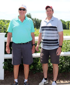 Jack Ladeau, left, and his son Ryan Ladeau teamed up to be the net winners of the Parent-Child/Adult Child Tournament, Sunday, at Gardner Municipal Golf Course.