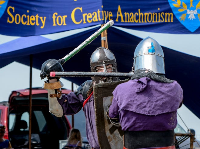 Members of the Society for Creative Anachronism, Wichita, provided shows of medieval battles Saturday, along with information to the public on the battle armor used and a history of the fights, at the Silver Sage Renaissance Festival at Finney County's Wildwood Park.  The two-day festival was in its inaugural year in Garden City.
