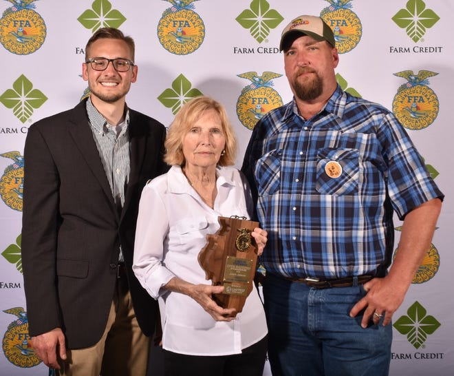 Cambridge FFA member Annie Johnson was named the state proficiency winner in swine production entrepreneurship during the state convention in June. From left to right are her advisor, Trent Taber, and her parents, Amanda and Justin Johnson.