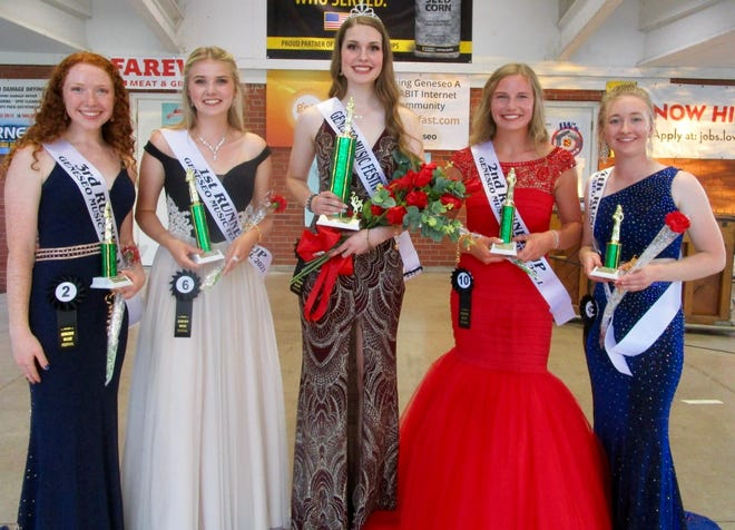 Madeline Possin, center, daughter of Simon and Kristi Possin, Geneseo,  Was crowned queen of the 2021 Geneseo Music Festival Queen Pageant Friday, June 18, in Geneseo City Park. Other members of the court are, from left, Morgan Simms, daughter of Chuck and Sue Simms, third runner-up; Mara Lowe, daughter of R.C. and Pam Lowe, first runner-up; Evie Wilson, daughter of Ryan and Kristin Wilson, 2nd runner-up; and Olivia Johnson, daughter of Matt and Alison Johnson, fourth runner-up. The queen and court reigned over the weekend of Music Festival festivities. The pageant is sponsored each year by the Geneseo Rotary Club and the queen receives $500 scholarship money, and each runner-up also receives scholarship money from the Rotary Club. Contestants not in the court were each given a $25 Geneseo gift certificate from Geneseo Rotary.