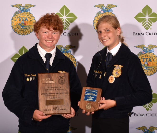 During the Illinois FFA convention in June, Cambridge FFA was named the state winner of the Strengthening Agriculture National Chapter Award. Pictured with the award are Tucker Snook, left, and Brooklyn Humphrey