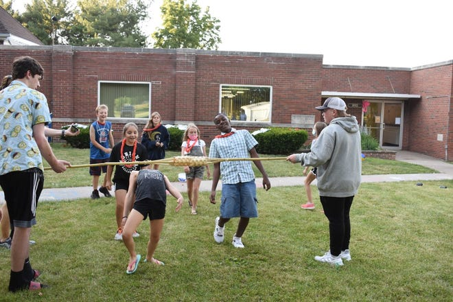 """""""Lava Lava Luau"""" was the theme of the 2021 Vacation Bible School at Augustana Lutheran Church, Andover. Activities on Tuesday, June 15, included the limbo on the church lawn"""